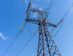 Electricity transmission power lines at sun. Stock Photos