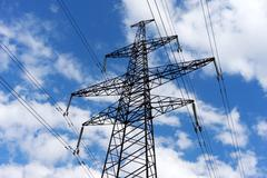 Electricity pylon against the blue sky background Stock Photos