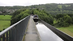 Pontcysyllte Aqueduct north east Wales uk barge crosses the canal waterway Stock Footage