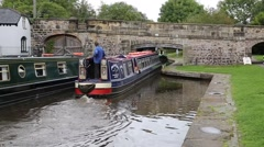 Barge sailing under bridge canal by Pontcysyllte Aqueduct Llangollen Wales UK Stock Footage