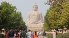 Pilgrims walking towards Great Buddha Statue,BodhGaya,India Stock Footage