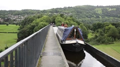 Barge crossing Pontcysyllte Aqueduct Llangollen Canal Wales uk Stock Footage
