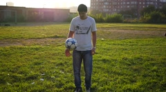 Man practicing with a ball on the soccer field Stock Footage