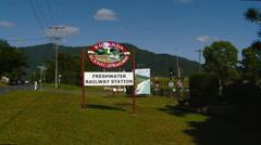 Cairns Australia - Zoom In Kuranda Scenic Railways Freshwater Railway Sign Stock Footage