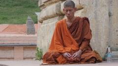 Monk meditating,BodhGaya,Mahabodhi Temple Complex,India Stock Footage