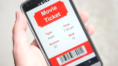 4K Movie Ticket Showing on Smartphone Screen app Stock Footage