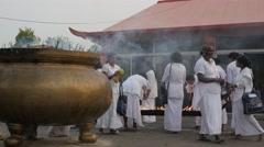 Pilgrims in white lighting candles,BodhGaya,Mahabodhi Temple Complex,India Stock Footage