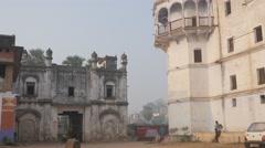 Woman walking through historical buildings,BodhGaya,India Stock Footage
