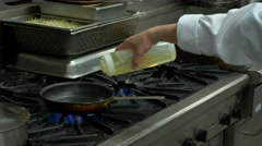 Cooking on industrial stove (part one) Stock Footage