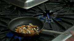 Cooking an omelette on industrial stove (part two) Stock Footage