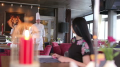 Chef serving delicious meal in his restaurant to female customer Stock Footage