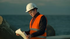 Builder Near the Sea Stock Footage