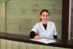 Woman on receptrion smiles and welcomes the virtual visitor at spa or modern Stock Photos