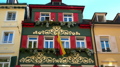 Baden-Baden bright red house with flag Stock Footage