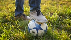 The guy rested one foot on a soccer ball Stock Footage
