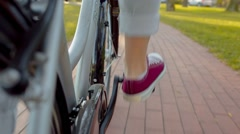 The Girl Pedaling on Bicycle Stock Footage