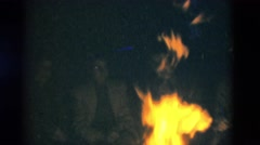 1949: a bonfire is seen lit people are seen sitting around it. SOMERSET Stock Footage