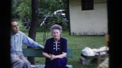 1949: a family outing is seen with couples sitting on benches SOMERSET, KENTUCKY Stock Footage