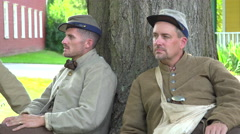 Two confederate Civil War soldiers near tree Stock Footage