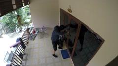 Burglar Trying to Break Open A House. 4K Stock Footage
