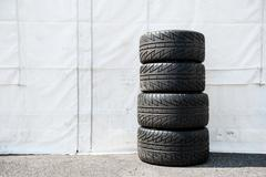 Set of motor sport car's wet racing tires Stock Photos