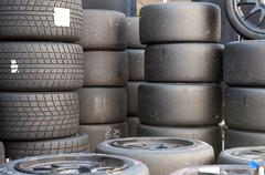 Many sets of motor sport car's slick and wet racing tires Stock Photos