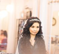 Stylish gorgeous bride getting makeup in the luxury beauty saloon with big Stock Photos