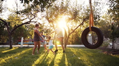 Children and parents playing at park Stock Footage
