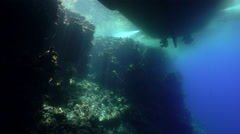 Silhouette of a boat and reef at sunlight - view from underwater Stock Footage