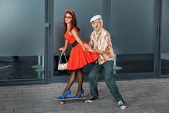 Woman riding on a skateboard. Stock Photos