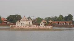 Temple on island in  Bindu Sagar lake,Bhubaneswar,India Stock Footage