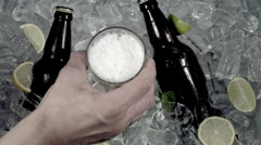 4k Shot of Cold Ice Cubes and Hand Taking Beer Glass Stock Footage