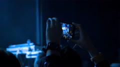 Girl taking photo with smartphone in the club at the concert, 4k Stock Footage