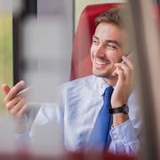 Happy businessman working Stock Photos