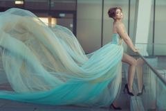 Young girl's dress developing in the wind. Stock Photos