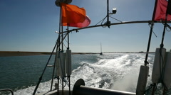 Fishing Vessel heading back to port, passing Orford Island, River Ore Stock Footage