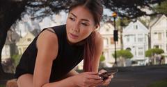 Asian woman resting after long run outdoors Stock Photos