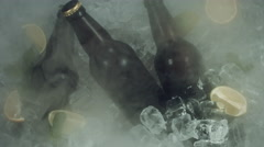 4k Shot of Cold Ice Cubes with Beer and Fog Blowed away Stock Footage