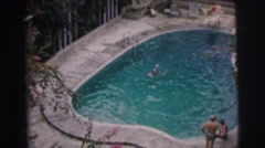1962: open swimming in a lovely in-ground pool. BANGKOK, THAILAND Stock Footage