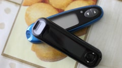 Two Glucose Meters Lying on a Table Stock Footage