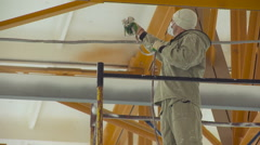 Male Painter Whitening the Shopfloor Ceiling With the Air Brush. Stock Footage