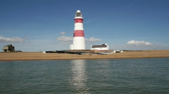 At sea sailing past Orford Ness Lighthouse Stock Footage