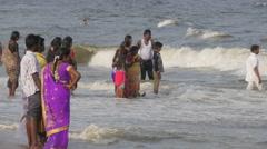 Women having fun in waves on marina beach,Chennai,India Stock Footage