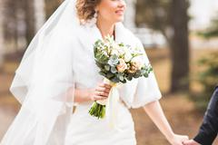 Bride with bridal bouquet in the autumn or winter park Stock Photos