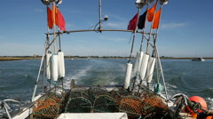 Fishing Vessel heading out to Sea with Orford in the distance, River Ore Stock Footage