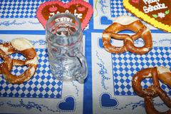Original bavarian pretzels with beer . Oktoberfest background Stock Photos