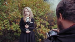 Photography shoot of a young woman in character of a scary white faced girl with Stock Footage