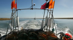Fishing Vessel heading out to Sea passing Havergate Island, River Ore Stock Footage