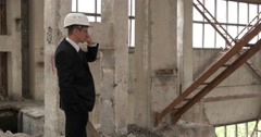Chief talking on the phone at the construction site Stock Footage