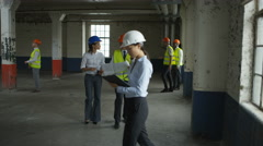 4K Architects or engineers discussing the plans at construction site Stock Footage